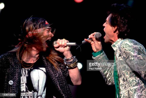 British musician Mick Jagger of the Rolling Stones performs on stage with American musician Axl Rose during the band's 'Steel Wheels' tour late 1989