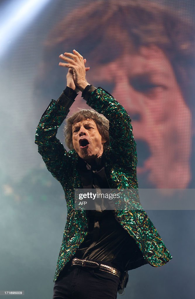 British musician Mick Jagger of the Rolling Stones performs on the Pyramid Stage on the fourth day of the Glastonbury Festival of Contemporary Performing Arts near Glastonbury, southwest England, on June 29, 2013. The festival attracts 170,000 party-goers to the dairy farm in Somerset, and this year's tickets sold out within two hours of going on sale. The Rolling Stones are will perform at the festival for the first time.