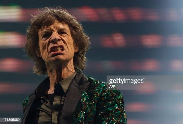 British musician Mick Jagger of the Rolling Stones performs on the Pyramid Stage on the fourth day of the Glastonbury Festival of Contemporary...