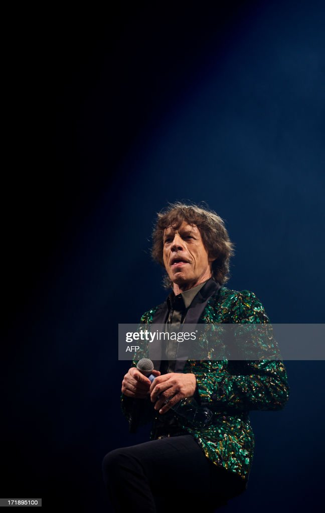 British musician Mick Jagger of the Rolling Stones performs on the Pyramid Stage on the fourth day of the Glastonbury Festival of Contemporary Performing Arts near Glastonbury, southwest England, on June 29, 2013. The festival attracts 170,000 party-goers to the dairy farm in Somerset, and this year's tickets sold out within two hours of going on sale. The Rolling Stones are will perform at the festival for the first time. AFP PHOTO/ANDREW COWIE