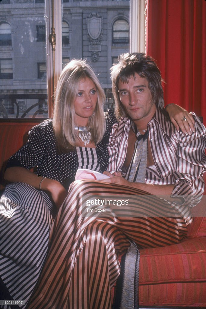 British musician <a gi-track='captionPersonalityLinkClicked' href=/galleries/search?phrase=Rod+Stewart&family=editorial&specificpeople=160467 ng-click='$event.stopPropagation()'>Rod Stewart</a> and his girlfriend, Swedish actress <a gi-track='captionPersonalityLinkClicked' href=/galleries/search?phrase=Britt+Ekland&family=editorial&specificpeople=158089 ng-click='$event.stopPropagation()'>Britt Ekland</a>, sits on a sofa in a hotel room while on a promotional tour in support of Stewart's album 'Atlantic Crossing,' New York, New York, July 29, 1975.