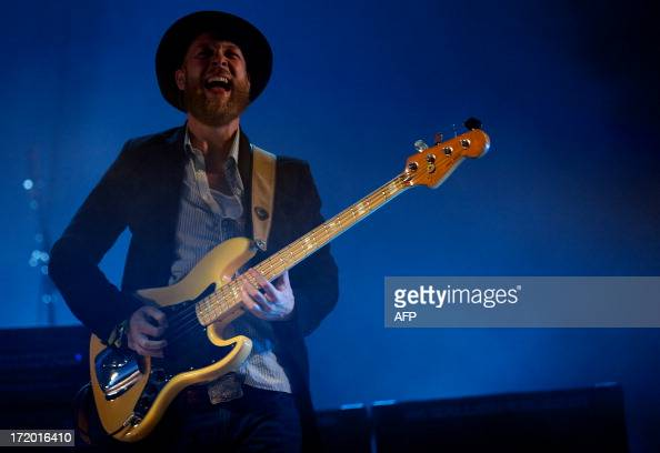 British musician Ted Dwane performs with the headline band Mumford and Sons on the Pyramid Stage on the fifth day of the Glastonbury Festival of...