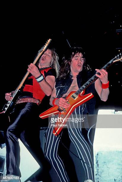 British musicians Dave Murray and Adrian Smith guitarists for the band Iron Maiden perform onstage at the University of Illinois Pavilion Chicago...