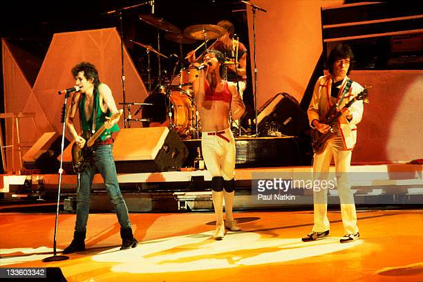 British musicians Keith Richards Mick Jagger and Ronnie Wood of the band The Rolling Stones perform on stage during a North American tour 1981