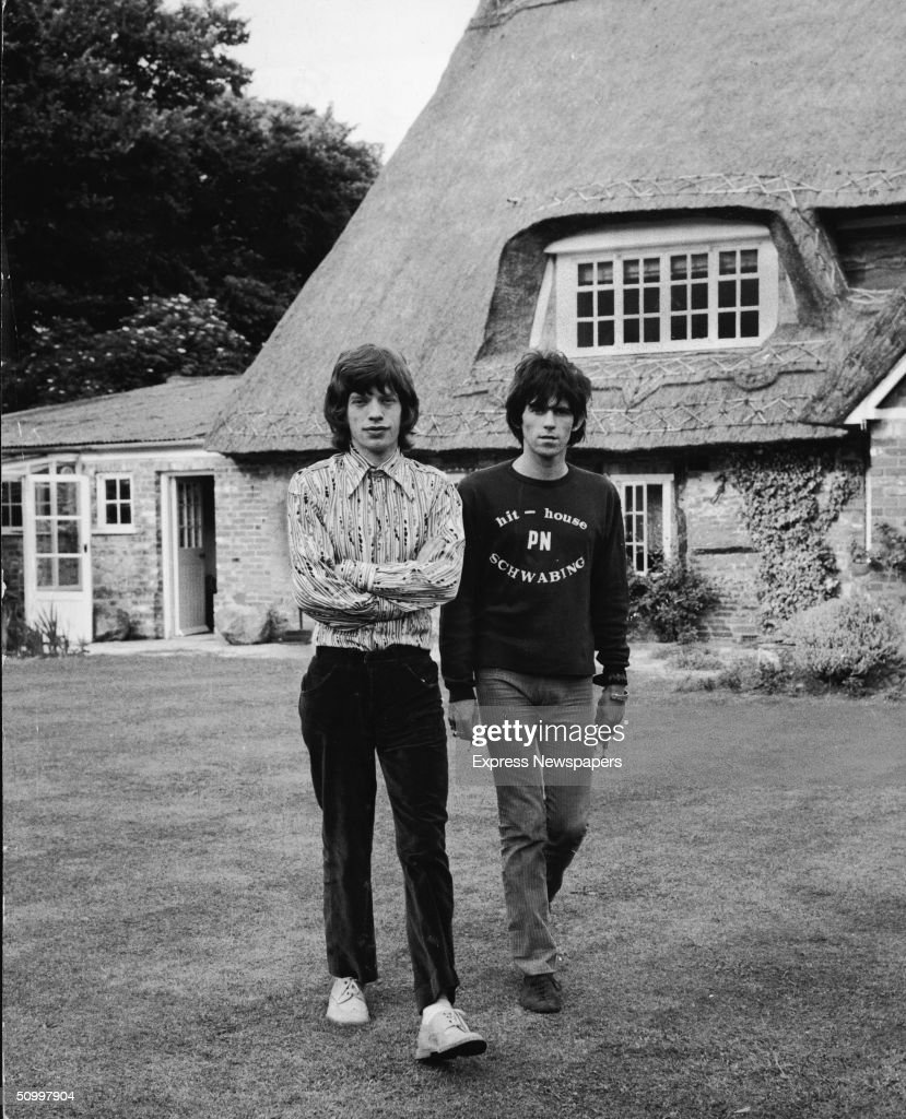 British musicians Mich Jagger (left) and <a gi-track='captionPersonalityLinkClicked' href=/galleries/search?phrase=Keith+Richards+-+Musician&family=editorial&specificpeople=202882 ng-click='$event.stopPropagation()'>Keith Richards</a> of the rock group The Rolling Stones walk in the garden of Redlands, Richards' Sussex house, after the disclosure of their sentences for drug violations, England, July 5, 1967. Jagger received three months for possession of four Italian pep pills and Richards recieved 12 months for allowing his home to be used for smoking Indian hemp.