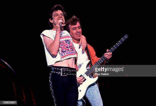 British musicians Mick Jagger and Bill Wyman of the Rolling Stones performs on stage during the band's 'Steel Wheels' tour late 1989
