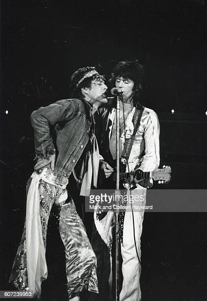 British musicians Mick Jagger and Keith Richards of the group the Rolling Stones perform onstage early 1973