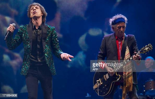 British musicians Mick Jagger Keith Richards and Charlie Watts of the Rolling Stones perform on the Pyramid Stage on the fourth day of the...