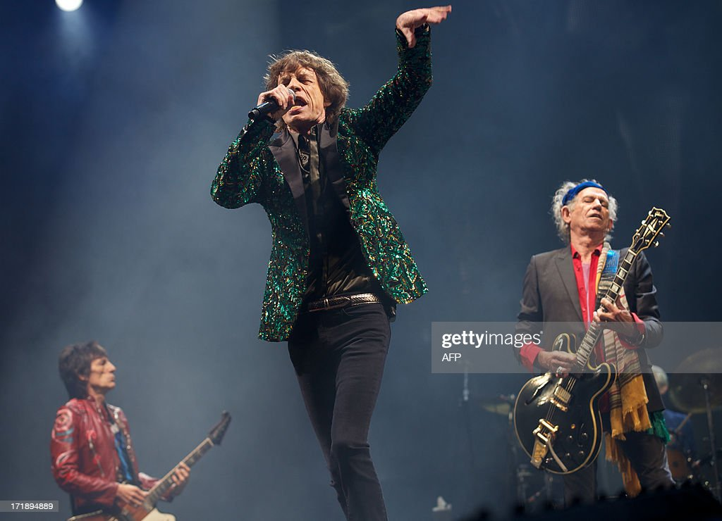 British musicians Mick Jagger (C), Keith Richards (R), Ronnie Wood (L) of the Rolling Stones perform on the Pyramid Stage on the fourth day of the Glastonbury Festival of Contemporary Performing Arts near Glastonbury, southwest England, on June 29, 2013. The festival attracts 170,000 party-goers to the dairy farm in Somerset, and this year's tickets sold out within two hours of going on sale. The Rolling Stones are will perform at the festival for the first time.