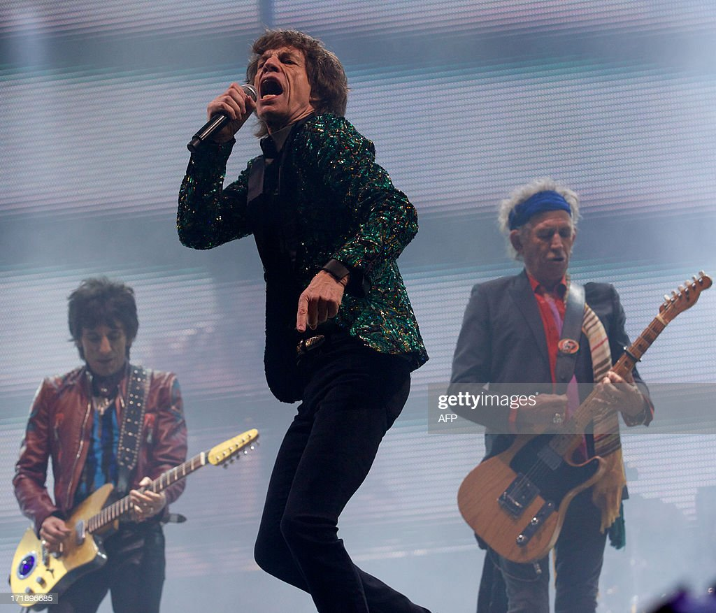 British musicians Mick Jagger (C), Ron Wood (L) and Keith Richards of the Rolling Stones perform on the Pyramid Stage on the fourth day of the Glastonbury Festival of Contemporary Performing Arts near Glastonbury, southwest England, on June 29, 2013. The festival attracts 170,000 party-goers to the dairy farm in Somerset, and this year's tickets sold out within two hours of going on sale. The Rolling Stones are will perform at the festival for the first time.
