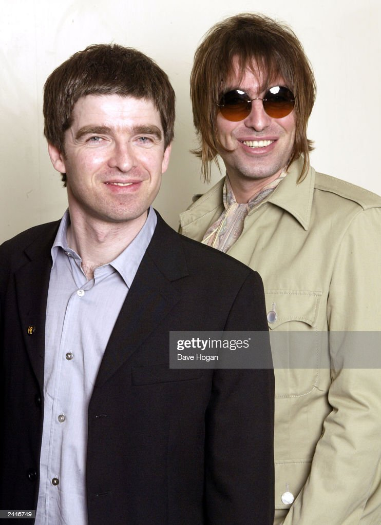 British musicians Noel (Left) and Liam (Right) Gallagher of Oasis attend the charity concert in aid of the 'Teenage Cancer Trust' at the Royal Albert Hall on March 26, 2003 in London.