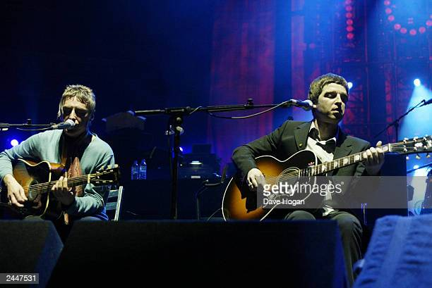 British musicians Noel Gallagher of 'Oasis' and Paul Weller perform on stage at the charity concert in aid of Teenage Cancer Trust at the Royal...