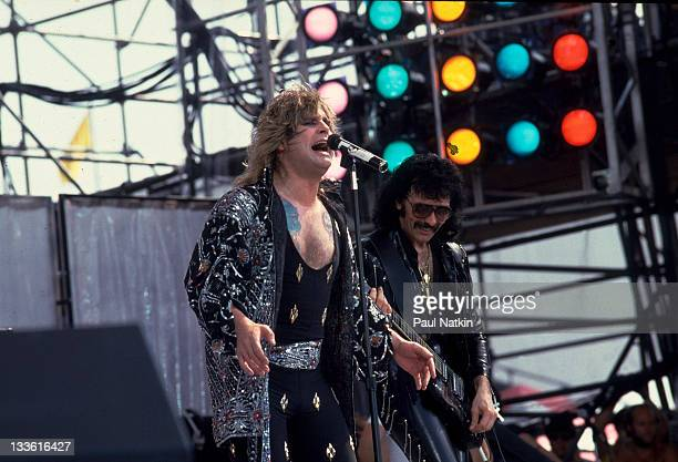 British musicians Ozzy Osbourne and Tony Iommi perform with Black Sabbath on stage at John F Kennedy Stadium for the Live Aid Concert Philadelphia...