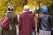 British Muslim Female Friends Walking In Urban Environment