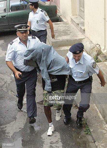 British national Michael Edwards is escorted by Greek police as he arrives at a court October 12 2006 in Iraklio on the Greek island of Crete Edwards...
