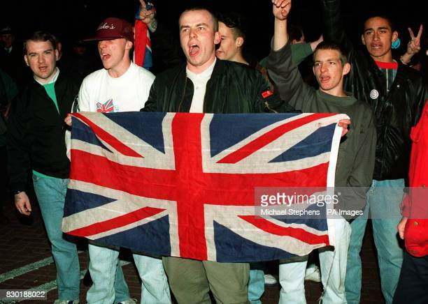 British National Party supporters celebrate after their candidate Derek Beackon won the Party's first council seat in a shock election result in...