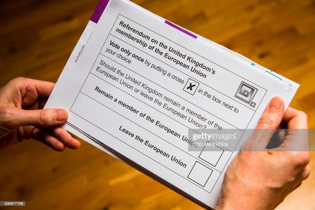 A British national receives her postal ballot paper, on May 30, 2016 in Berlin for the upcoming EU referendum scheduled for June 23rd. British citizens that have lived abroad for less than 15 years are eligible to vote but around two million Brits wont be able to in the UKs upcoming referendum on its membership in the European Union. / AFP / ODD