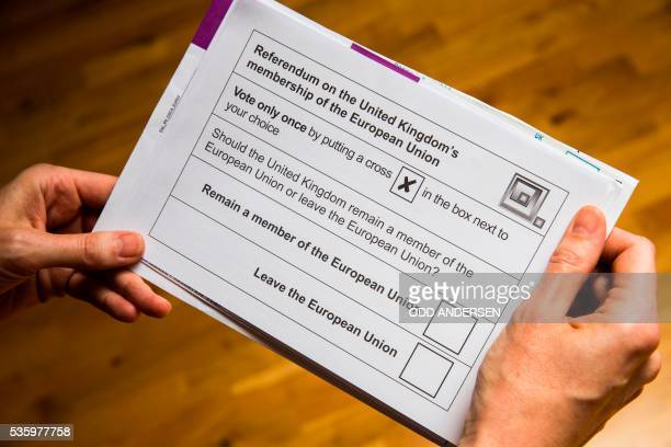 A British national receives her postal ballot paper on May 30 2016 in Berlin for the upcoming EU referendum scheduled for June 23rd British citizens...