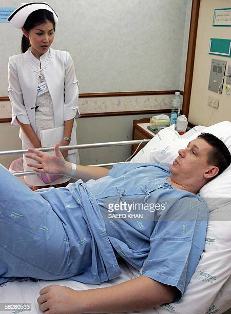STORY 'AFPLIFESTYLEHEALTHASIATOURISM' British national Richard Newman tells his condition to a Thai nurse following his surgery to remove fat at...