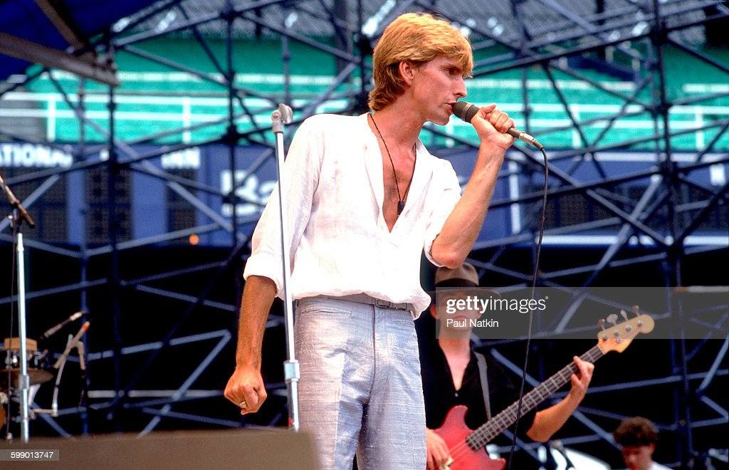British New Wave musician Cy Curnin of the Fixx performs onstage at Comiskey Park Chicago Illinois July 23 1983