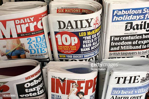 British newspaper are displayed for sale on the day that the Conservatives Labour and Lib Dems agree a deal on press reform on March 18 2013 in...