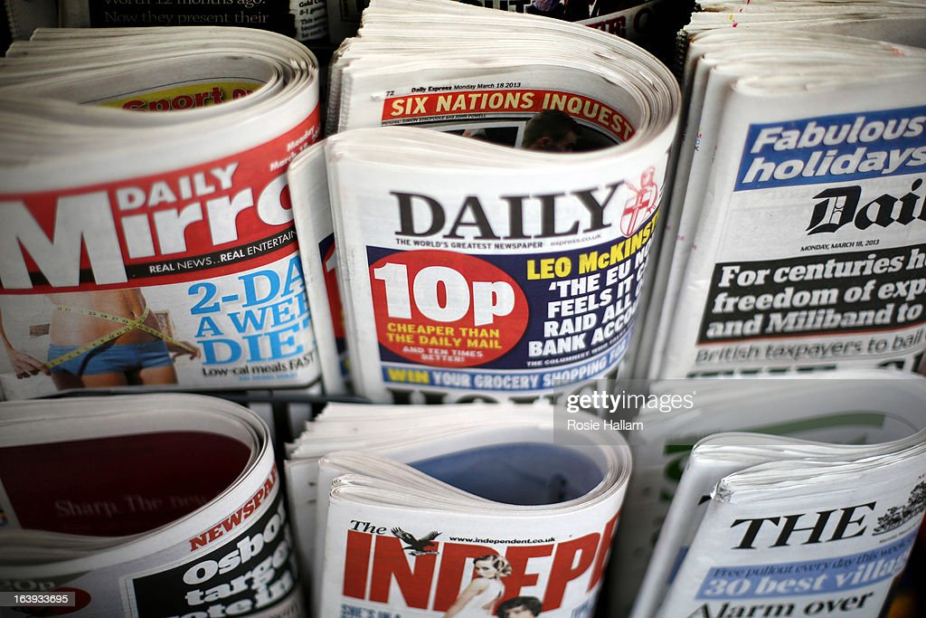British newspaper are displayed for sale on the day that the Conservatives, Labour and Lib Dems agree a deal on press reform on March 18, 2013 in London, England. A Press regulation deal has been agreed today by Conservatives, Labour and Lib Dems following a call for reform in the wake of Lord Justice Leveson's inquiry into press ethics and phone hacking.
