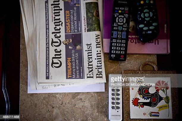 British newspaper The Telegraph lies on a table in British retiree George Rush and his wife Belgian Paulette's house at the Monte da Palhagueira...