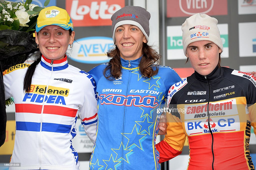 British Nikki Harris, British Helen Wyman and Belgian Sanne Cant celebrate on the podium after the first stage of the Superprestige cyclocross cycling competition, the 'Hansgrohe Superprestige Ruddervoorde', , on October 2013 in Ruddervoorde, Oostkamp. AFP PHOTO BELGA DAVID STOCKMAN Belgium Out