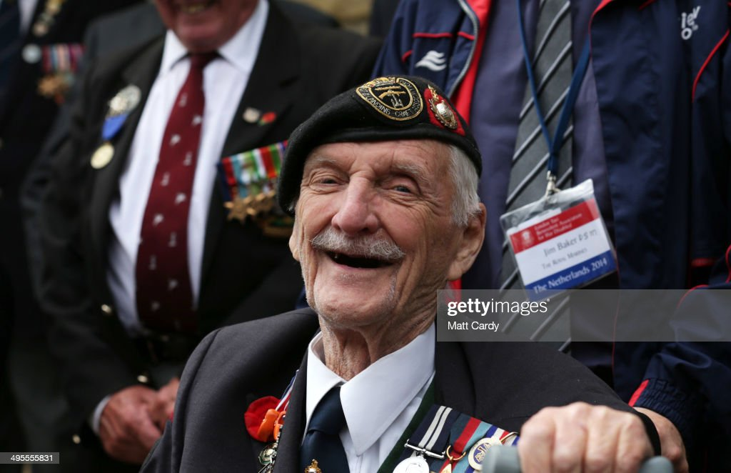 British Normandy Veteran Jim Baker, 91, who was in the Royal Marines on D-Day, laughs as he joins for a group photograph with the local mayor at a civic function in the village of Thury-Harcourt on June 4, 2014 near Caen in Normandy, France. Friday 6th June is the 70th anniversary of the D-Day landings which saw 156,000 troops from the allied countries including the United Kingdom and the United States join forces to launch an audacious attack on the beaches of Normandy, these assaults are credited with the eventual defeat of Nazi Germany. A series of events commemorating the 70th anniversary are planned for the week with many heads of state travelling to the famous beaches to pay their respects to those who lost their lives.