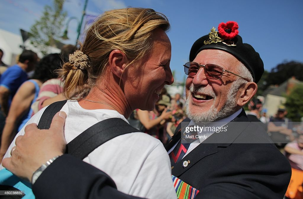 British Normandy Veteran Joe Cattini, 91, who was in the Herefordshire Yeomanry on Gold Beach on D-Day greets a well wisher as he visits Sainte-Mere-Eglise as they hold D-Day Commemorations on June 7, 2014 in Normandy, France. Yesterday was the 70th anniversary of the D-Day landings, which saw 156,000 troops from the allied countries including the United Kingdom and the United States join forces to launch an audacious attack on the beaches of Normandy, these assaults are credited with the eventual defeat of Nazi Germany.