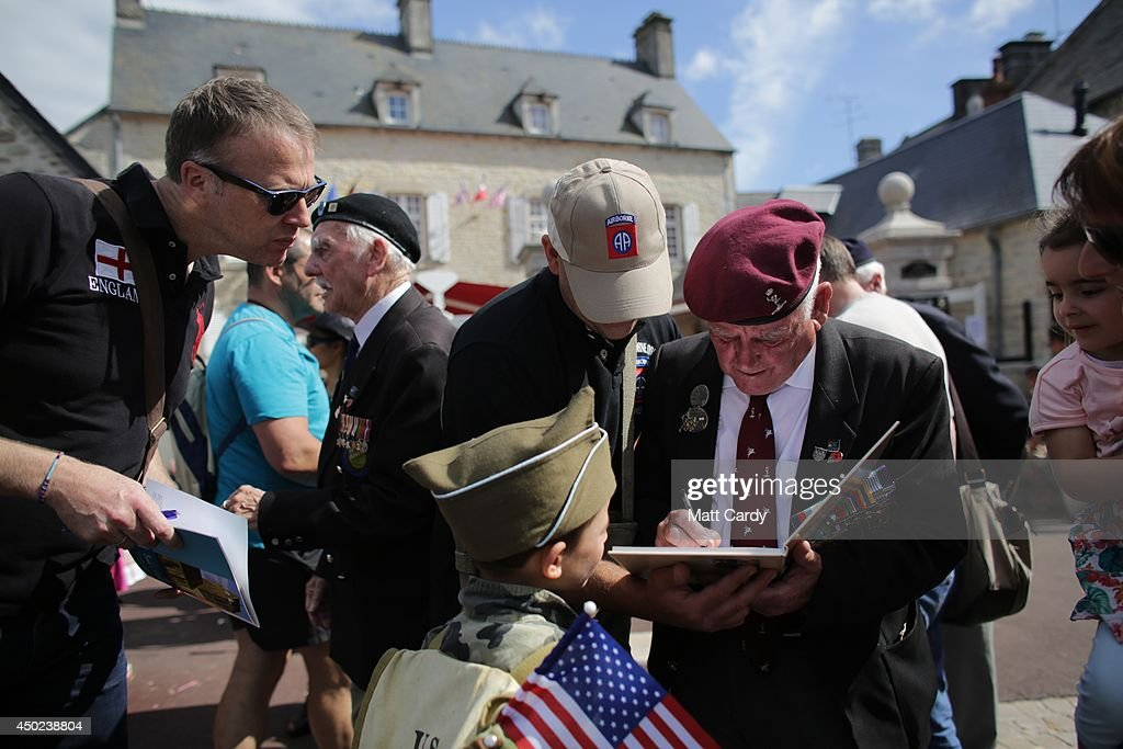 British Normandy Veterans are greeted by people as they visit Sainte-Mere-Eglise which is holding D-Day Commemorations on June 7, 2014 in Normandy, France. Yesterday was the 70th anniversary of the D-Day landings, which saw 156,000 troops from the allied countries including the United Kingdom and the United States join forces to launch an audacious attack on the beaches of Normandy, these assaults are credited with the eventual defeat of Nazi Germany.