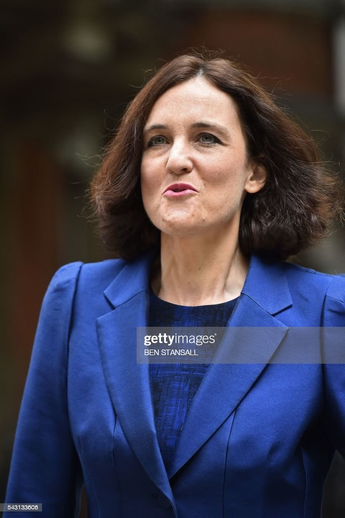 British Northern Ireland Secretary Theresa Villiers walks through Westminster in central London on June 26, 2016. The future of opposition Labour leader Jeremy Corbyn looked shaky on Sunday after two members of his top team quit and others seemed set to follow over his handling of Britain's EU referendum. Corbyn sacked his foreign affairs spokesman, Hilary Benn, late Saturday after Benn said he no longer had confidence in his leadership, while health spokeswoman Heidi Alexander announced her resignation on Twitter Sunday. / AFP / BEN