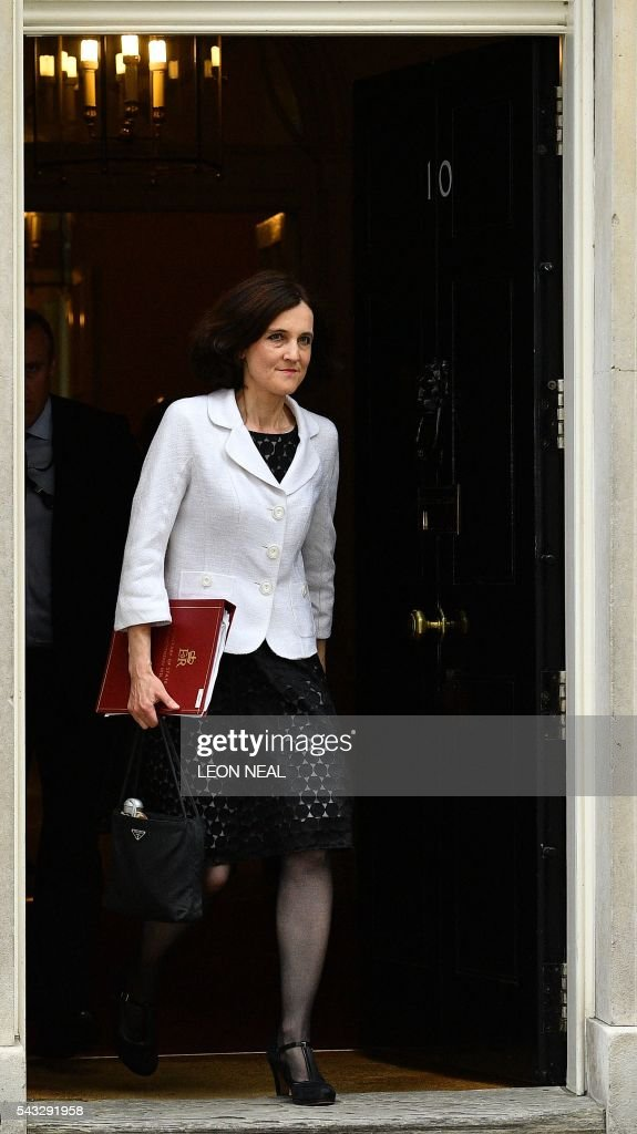 British Northern Ireland Secretary Theresa Villiers walks through the door of 10 Downing Street after attending a cabinet meeting in central London on June 27, 2016. European stock markets mostly slid Monday as British finance minister George Osborne attempted to calm jitters after last week's shock Brexit referendum. Britain's surprise referendum decision to leave the European Union wiped $2.1 trillion off market valuations on Friday and sent the pound collapsing to a 31-year low against the dollar. / AFP / LEON
