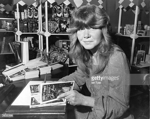British novelist and writer Jilly Cooper signing copies of her anthology 'The British in Love' at Barkers department store in Kensington London