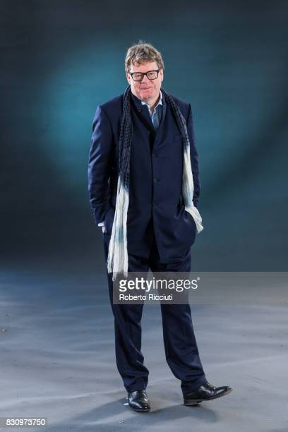 British novelist documentary filmmaker television producer and playwright James Runcie attends a photocall during the annual Edinburgh International...
