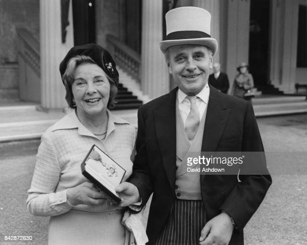 British novelist Ralph Hammond Innes with his wife Dorothy after receiving an OBE at Buckingham Palace London 26th October 1978