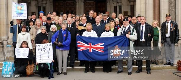 British nuclear bomb test veterans gather with their families outside the High Court London where they are taking their multimillion pound...