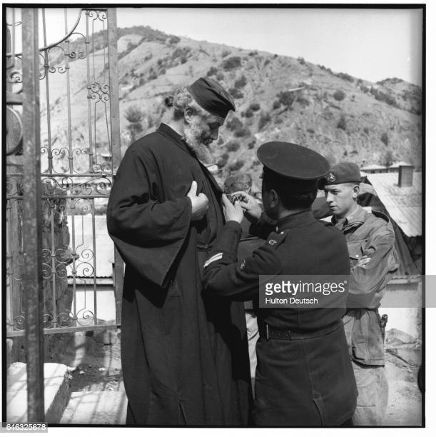 A British officer searches an abbot in Cyprus due to the presense of EOKA terrorists