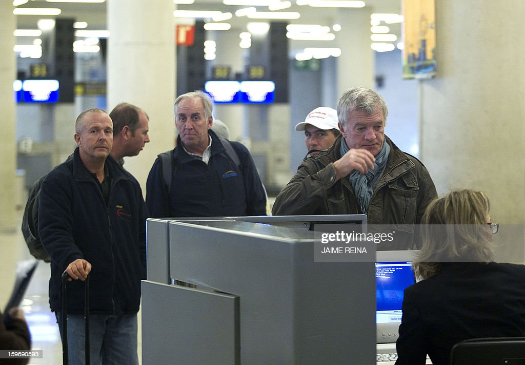 British oil giant BP's employees wait for their flight back to London at the Palma de Mallorca airport on January 18, 2013. Foreign workers leave Algeria following an Algerian army rescue operation launched at the In Amenas plant on January 17, 2013 after kidnappers seized hostages at the site in what they said was retaliation for Algeria's support for French air strikes in Mali. AFP PHOTO/ JAIME REINA