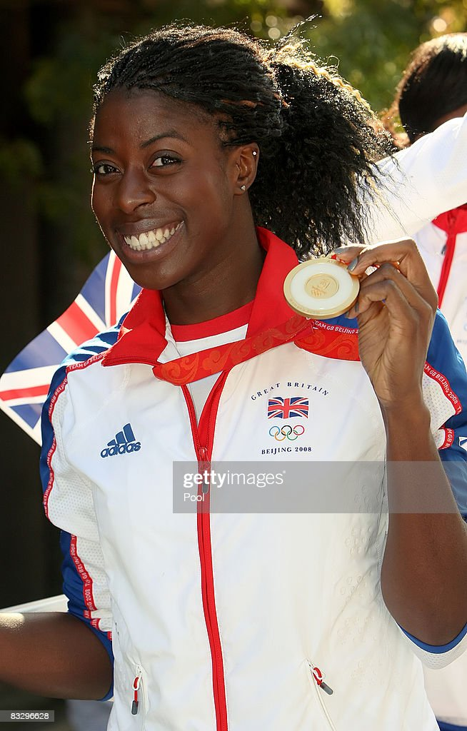British Olympic 400m gold medalist, <a gi-track='captionPersonalityLinkClicked' href=/galleries/search?phrase=Christine+Ohuruogu&family=editorial&specificpeople=703549 ng-click='$event.stopPropagation()'>Christine Ohuruogu</a> poses with her medal during the Olympic and Paralympic Heroes Parade on October 15, 2008 in London.