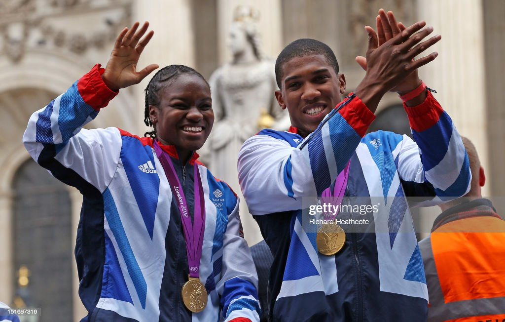 British Olympic boxing gold medalists Nicola Adams and Anthony Joshua wave to the crowd as as they go past St Paul's during the London 2012 Victory...