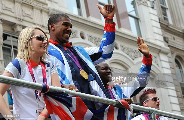 British Olympic boxing gold medalists Nicola Adams and Anthony Joshua wave to the crowds during the London 2012 Victory Parade for Team GB and...