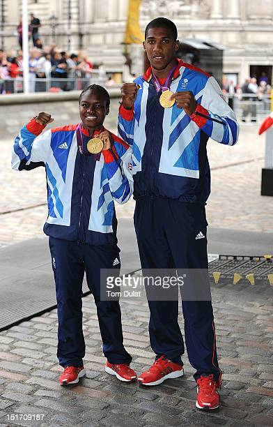 British Olympic boxing gold medalists Nicola Adams and Anthony Joshua pose for photographs during the reception for Team GB and Paralympic GB...
