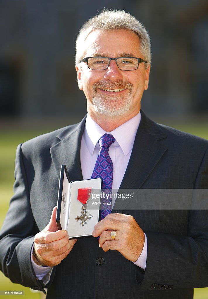 British Olympic canoeing coach Eric Farrell poses after receiving his Member of the British Empire (MBE) from the Princess Anne, Princess Royal at Windsor Castle on October 20, 2011 in Windsor, England.