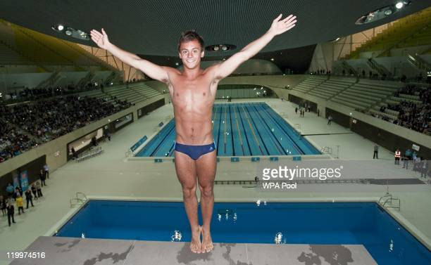 British Olympic diver Tom Daley prepares to perform a dive into the dive pool at the Aquatics Centre venue for the London 2012 Olympic Games at the...