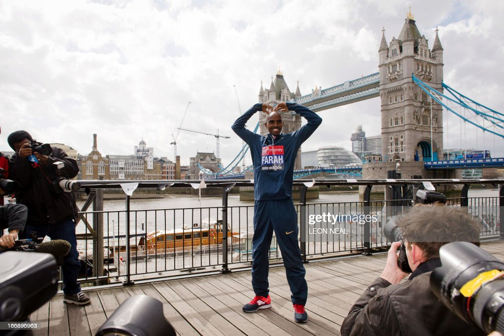 British Olympic double gold medallist Mo Farah makes his trademark 'Mobot' gesture as he poses for photographers in central London on April 18, 2013 during a photo call ahead of the London marathon. The London Marathon will go ahead as planned on April 21, 2013 after security arrangements were reviewed in the wake of the bombings that caused carnage at the Boston Marathon, organisers and police said.