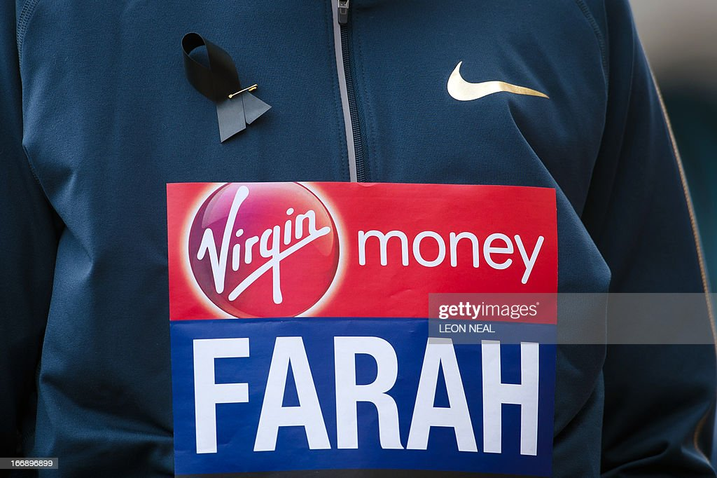 British Olympic double gold medallist Mo Farah wears a black ribbon to remember the victims of the Boston marathon as he poses for photographers in central London on April 18, 2013 during a photo call ahead of the London marathon. The London Marathon will go ahead as planned on April 21, 2013 after security arrangements were reviewed in the wake of the bombings that caused carnage at the Boston Marathon, organisers and police said. AFP PHOTO/LEON NEAL
