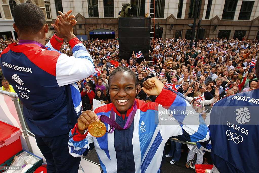 British Olympic gold medal winning boxer Nicola Adams smiles as she holds her medal during the London 2012 Victory Parade for Team GB and Paralympic...