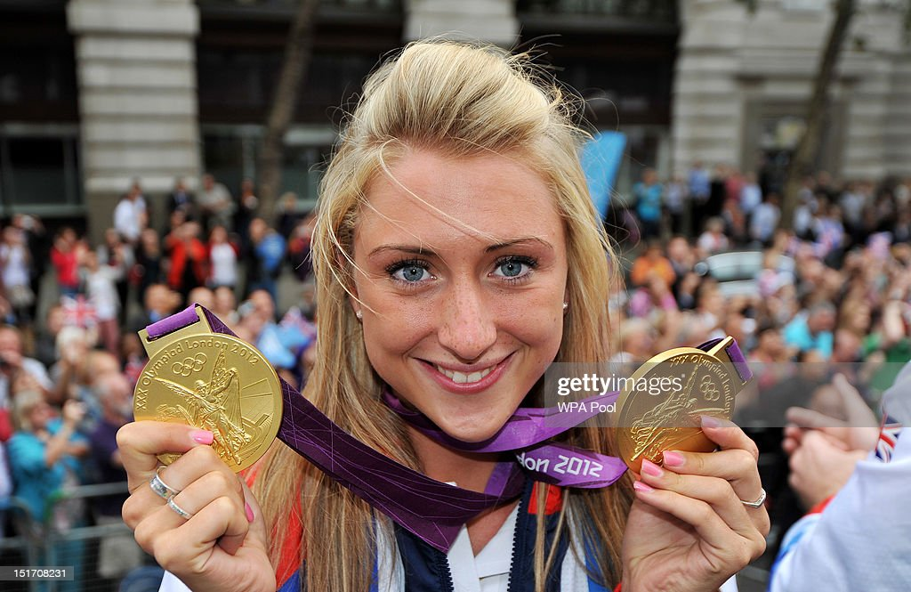 British Olympic gold medal winning cyclist <a gi-track='captionPersonalityLinkClicked' href=/galleries/search?phrase=Laura+Trott&family=editorial&specificpeople=7205074 ng-click='$event.stopPropagation()'>Laura Trott</a> shows her gold medals during the London 2012 Victory Parade for Team GB and Paralympic GB athletes on September 10, 2012 in London, England.