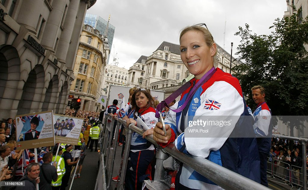 British Olympic silver medal winning equestrian athlete Zara Phillips holds her Three Day Event silver medal as he takes part in the parade passing St Paul's Cathedral during the London 2012 Victory Parade for Team GB and Paralympic GB athletes on September 10, 2012 in London, England.